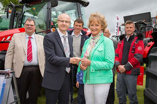 Laurent Pernin - Director, Sales MF, Europe & Turkey hands the keys of an MF 5610 Antarctica2 Special Edition tractor to winner Nancie Clanachan at the Royal Highland Show 2015. Left to right: Campbell Scott - Massey Ferguson Director Marketing Services, Laurent Pernin, Stuart Clanachan, Winner Nancie Clanachan, Donald Clanachan, Simon Foster - Antarctica2 Creative Director and Audio-Visual Lead.